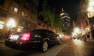 limo on NY street at night